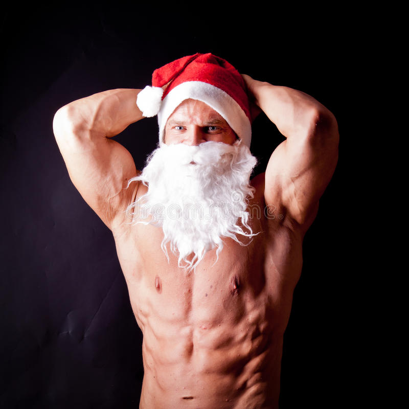 Le père noël musculaire photo stock