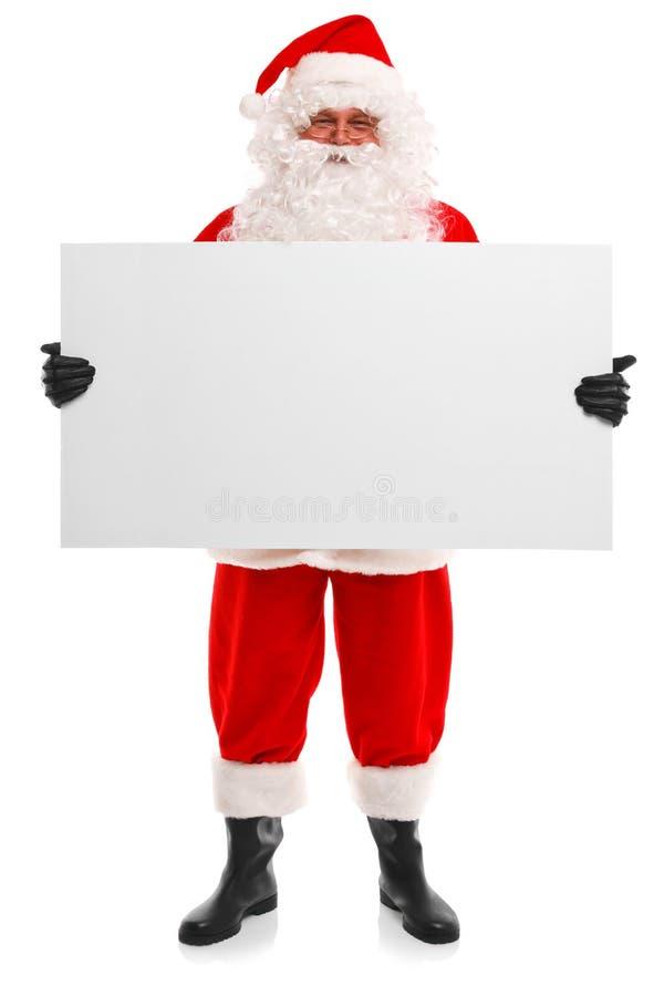 Le père noël retenant un signe blanc photos stock