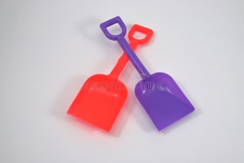 Le pale del giocattolo usano i bambini dby su fondo bianco immagine stock