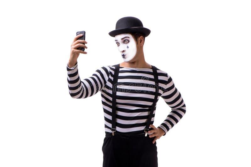 Le pantomime avec le smartphone d'isolement sur le fond blanc images stock