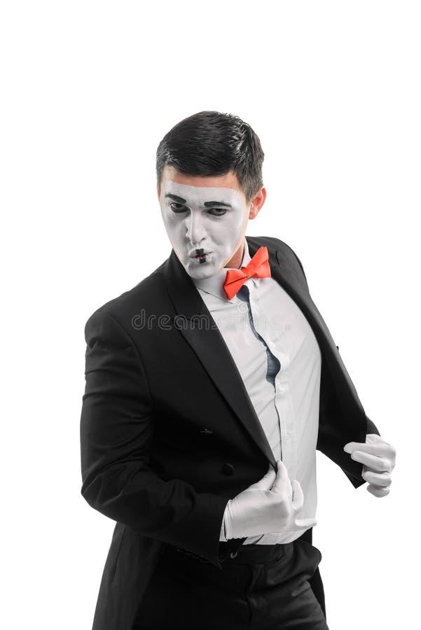 Le pantomime masculin redresse sa veste photos libres de droits
