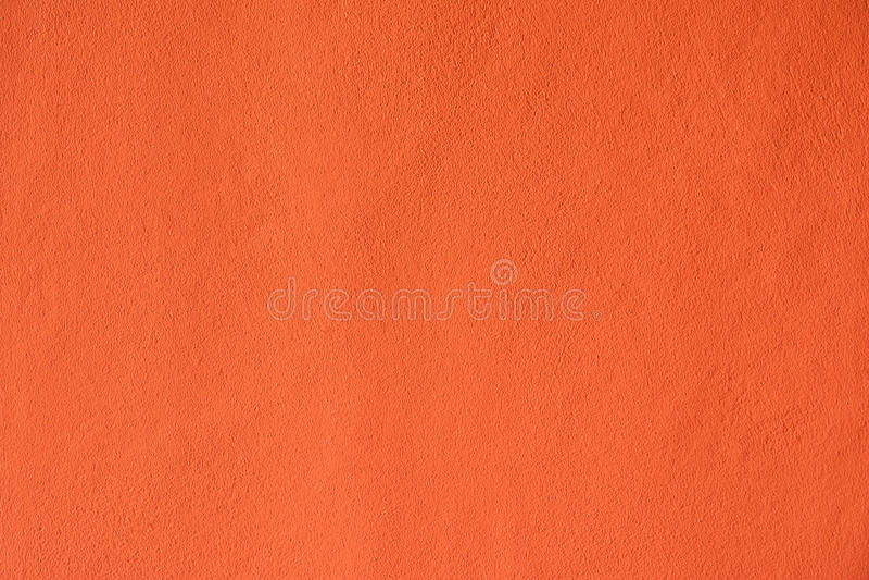 Le pareti del cemento dipinte arancio immagini stock