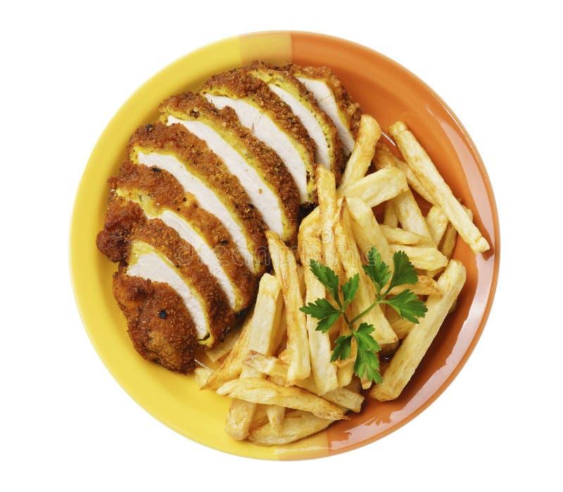 Le patate fritte ed il pollo sul bianco hanno isolato il fondo fotografia stock libera da diritti