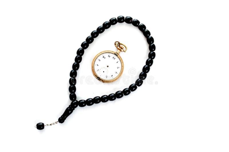 le perle di preghiera e la tasca d'annata cronometrano, cronometrano per pregare fotografie stock libere da diritti