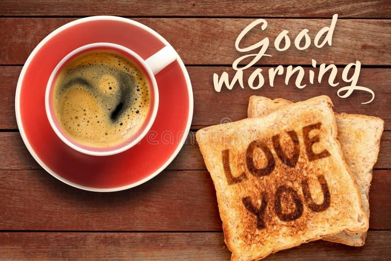 Le petit déjeuner, le café et le pain grillé avec le texte vous aiment photographie stock libre de droits