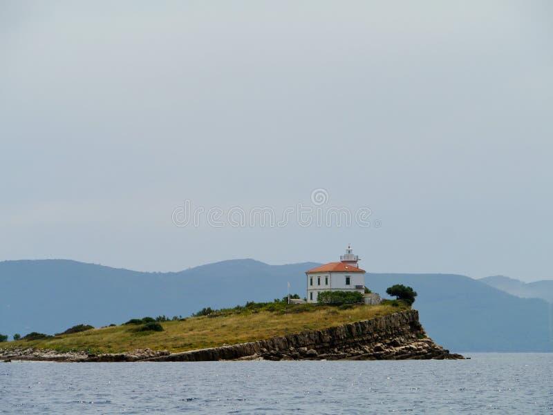 Le phare de Plocica dans le méditerranéen photo stock