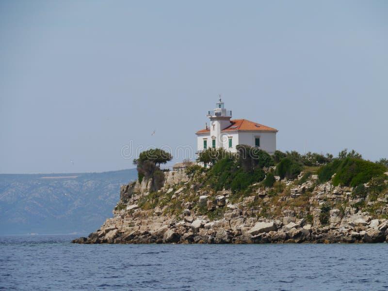 Le phare de Plocica en Mer Adriatique de la Croatie photo stock