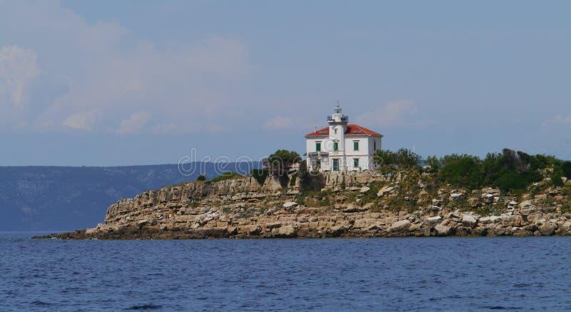 Le phare de Plocica en Mer Adriatique de la Croatie images stock