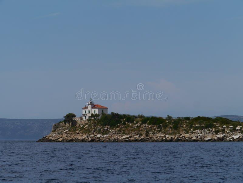 Le phare de Plocica en Mer Adriatique de la Croatie photo libre de droits