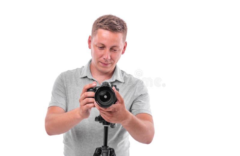 Le photographe avec la caméra sur le blanc photographie stock libre de droits