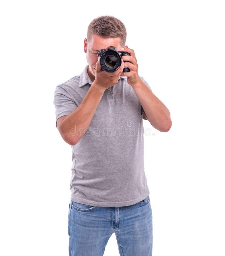 Le photographe avec la caméra sur le blanc image libre de droits