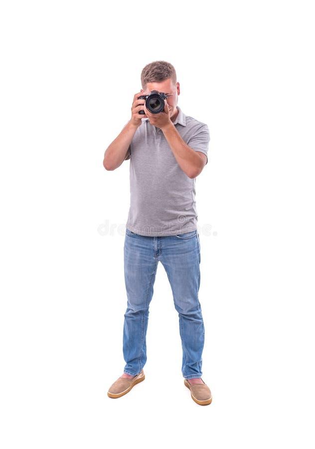 Le photographe avec la caméra sur le blanc image stock
