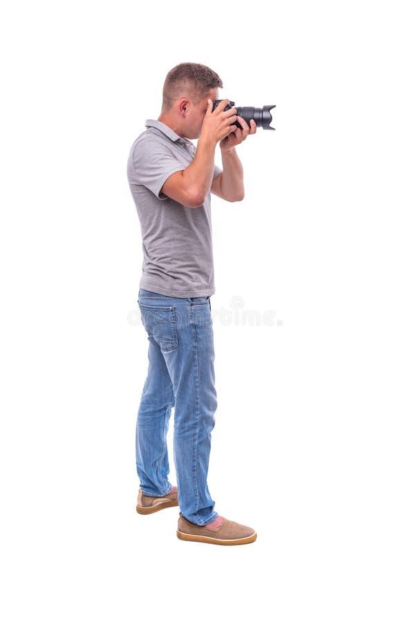 Le photographe avec la caméra sur le blanc photographie stock
