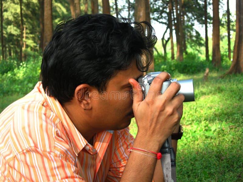 Le photographe occupé image libre de droits
