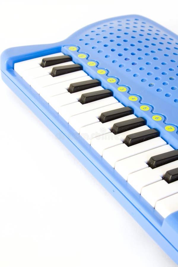 Le piano de l'enfant photos stock