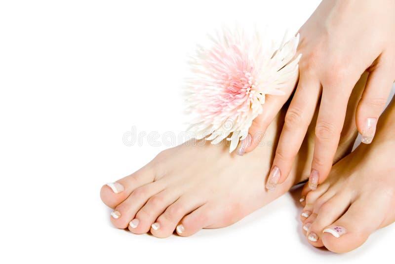 Le pied et la main de la femme avec le flo photo libre de droits