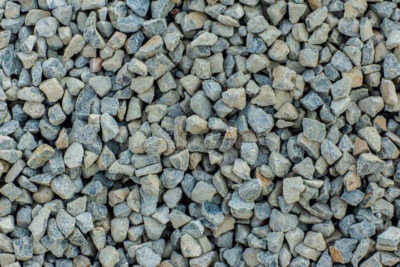 Le pietre strutturano e fondo Oscilli la struttura Fondo schiacciato della ghiaia fotografia stock