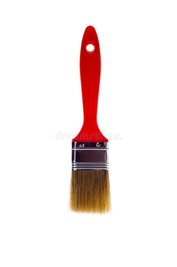 Le pinceau avec la poignée rouge photographie stock libre de droits