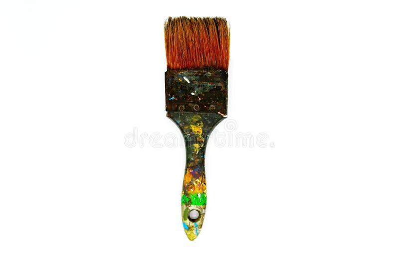 Le pinceau sale soit souillé avec la couleur sur le fond blanc d'isolement photographie stock libre de droits