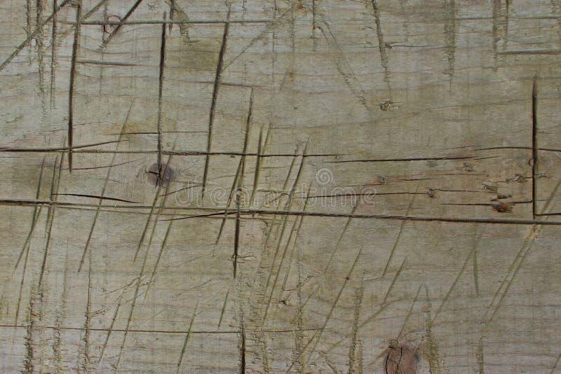Le piste profonde del coltello sul banco di legno strutturano il fondo immagini stock