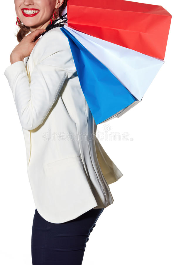 Le plan rapproché sur la femme heureuse avec le drapeau français colore des paniers photographie stock