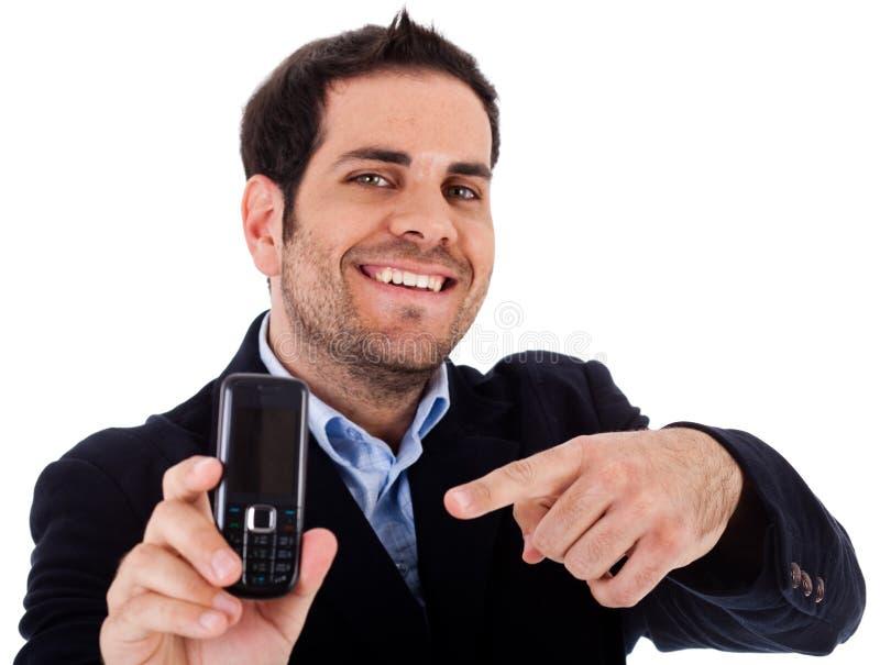 Le plan rapproché a tiré du point d'homme d'affaires le mobile photos libres de droits