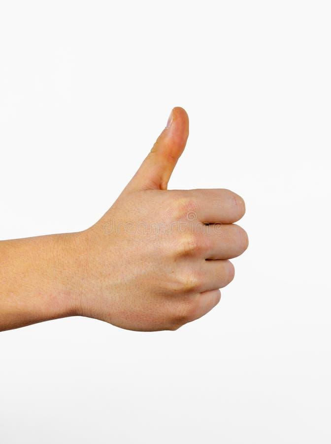 Le plan rapproch? de la main masculine montrant des pouces l?vent le signe images libres de droits