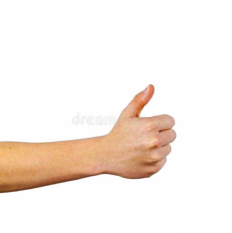 Le plan rapproch? de la main masculine montrant des pouces l?vent le signe photographie stock libre de droits