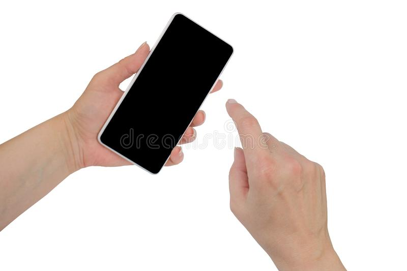 Le plan rapproch? a tir? d'une femme dactylographiant au t?l?phone portable sur le fond blanc La main de la fille tenant un smart photographie stock