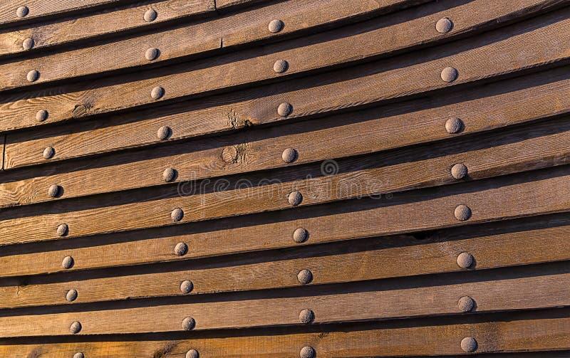 Le plat en bois de rivet de fond de structure de bateau de conseil a collé le mur de mer historique de fond photographie stock