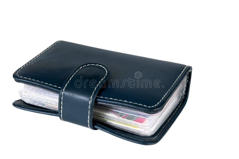 Le portefeuille en cuir obscurément bleu avec des cartes de crédit à l'intérieur photo stock