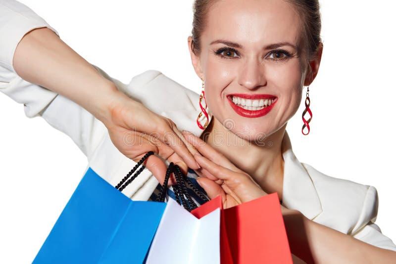 Le portrait étroit de la femme avec le drapeau français colore des paniers photo stock