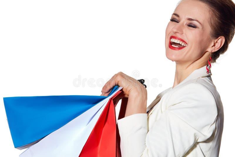 Le portrait étroit de la femme avec le drapeau français colore des paniers images libres de droits