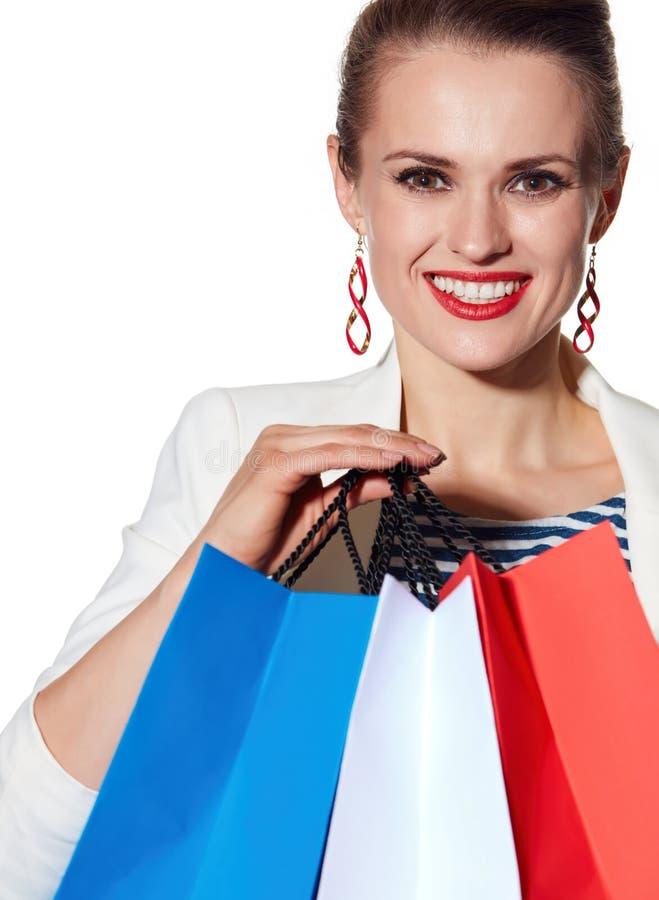 Le portrait étroit de la femme avec le drapeau français colore des paniers photo libre de droits