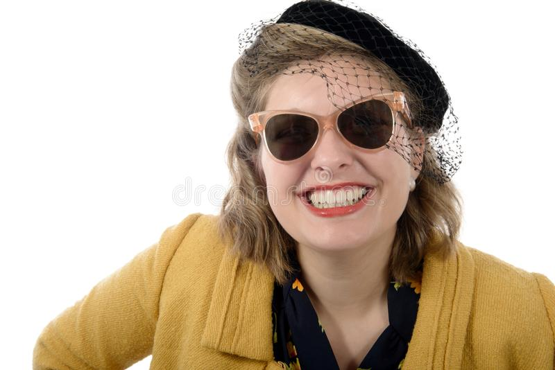 Le portrait d'une belle femme avec le vintage vêtx photographie stock