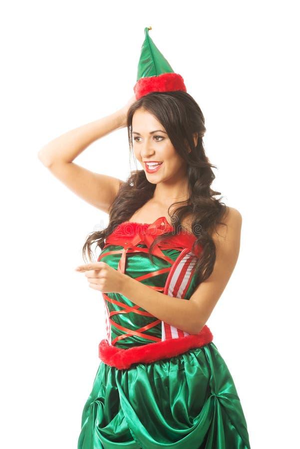 Le portrait de l'elfe de port de femme vêtx l'indication la gauche photographie stock libre de droits