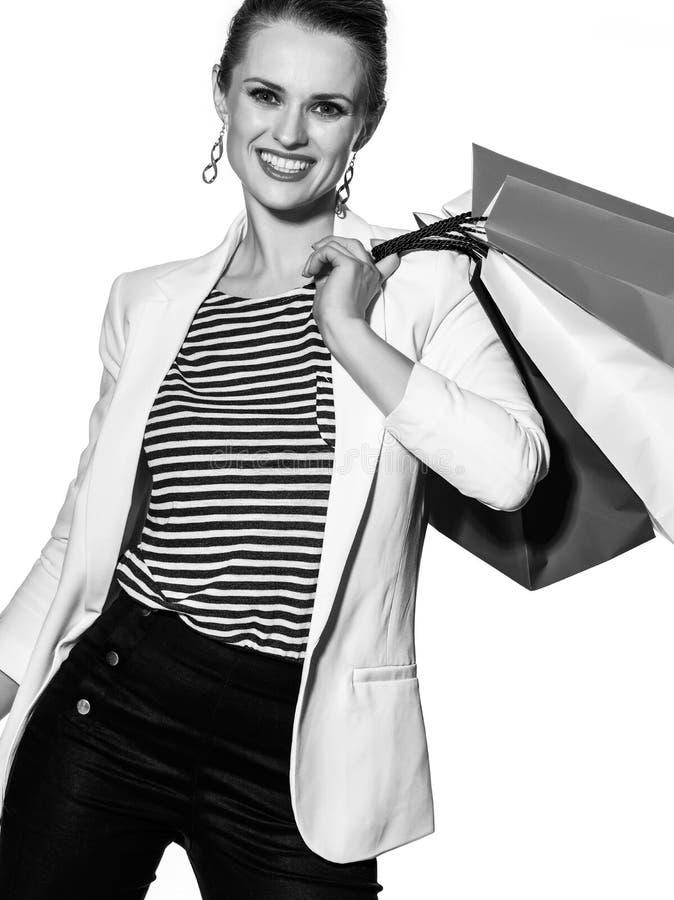 Le portrait de la femme heureuse avec le drapeau français colore des paniers images libres de droits