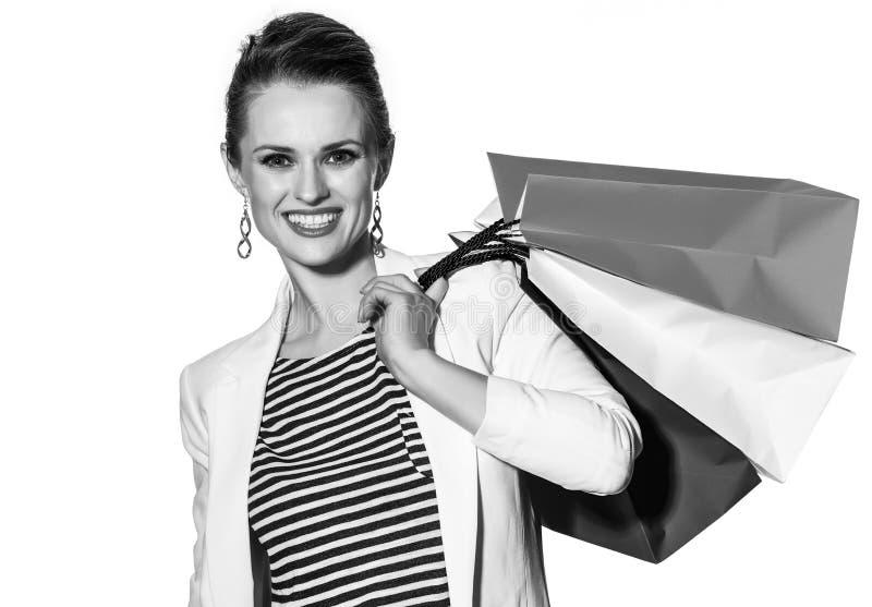 Le portrait de la femme heureuse avec le drapeau français colore des paniers photo stock