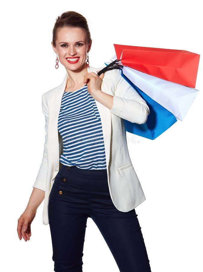 Le portrait de la femme heureuse avec le drapeau français colore des paniers photographie stock