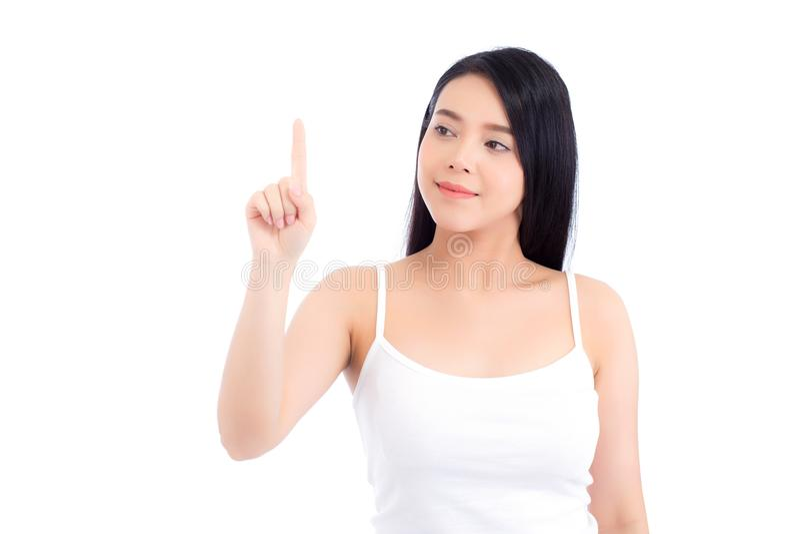 Le portrait du beau maquillage asiatique de femme du cosmétique, la beauté de la fille avec le sourire de visage et le doigt diri image libre de droits