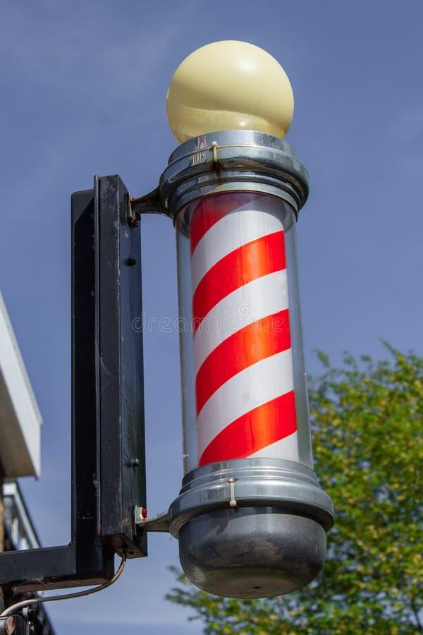 Le poteau du coiffeur traditionnel mis à jour image libre de droits