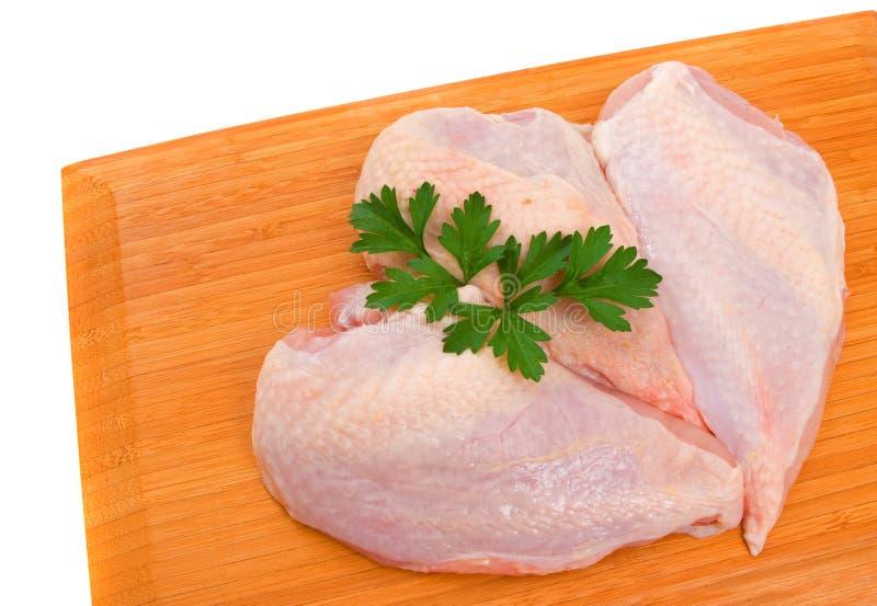 le poulet de sein ceint d'un bandeau trois images stock