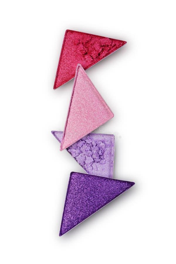Le pourpre et le rose ont écrasé le fard à paupières de triangle pour le maquillage brillant lumineux comme échantillon de produi photo stock