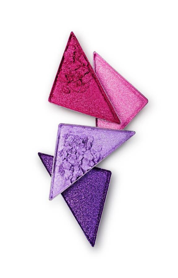 Le pourpre et le rose ont écrasé le fard à paupières de triangle pour le maquillage brillant lumineux comme échantillon de produi image stock