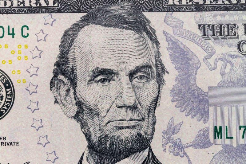 Le Président Lincoln sur la photo de macro de billet de cinq dollars Détail de devise des Etats-Unis d'Amérique photo stock