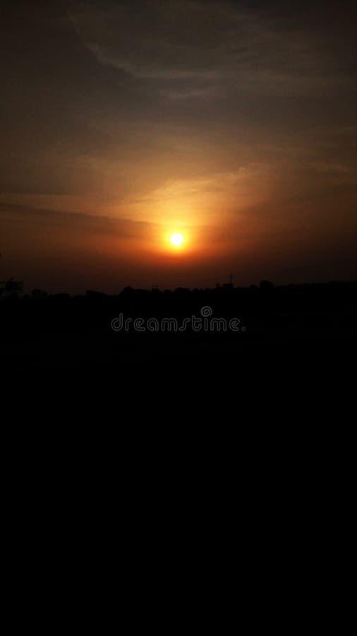 Le premier rayon dans la terre le matin photographie stock