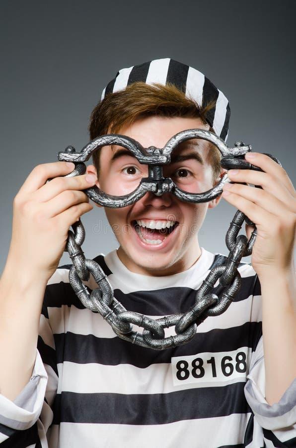 Le prisonnier drôle dans le concept de prison photographie stock