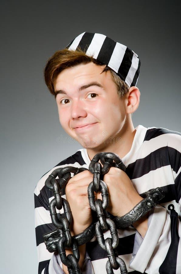 Le prisonnier drôle dans le concept de prison photos stock