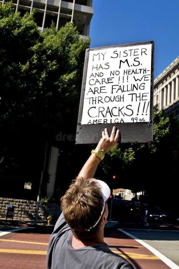 Le protestataire retardent le signe à occupent L.A. photos stock