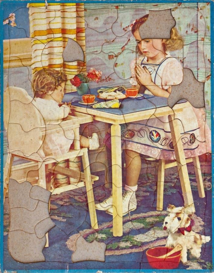 Le puzzle des enfants antiques, nous a laissés être reconnaissants photo libre de droits
